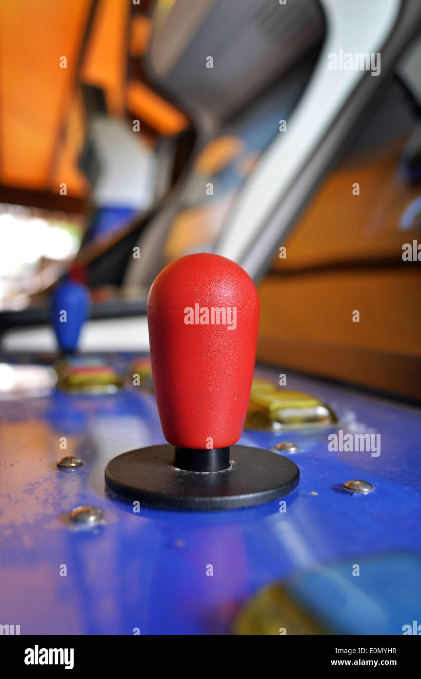 Joystick of a vintage arcade videogame in a public game room - Stock Image