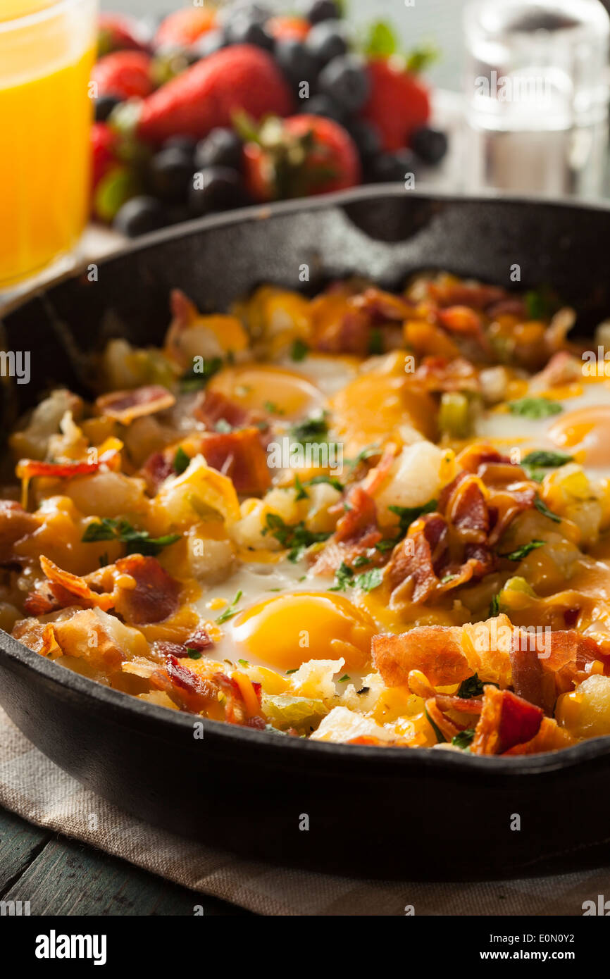 Homemade Hearty Breakfast Skillet with Eggs Potatoes and Bacon - Stock Image