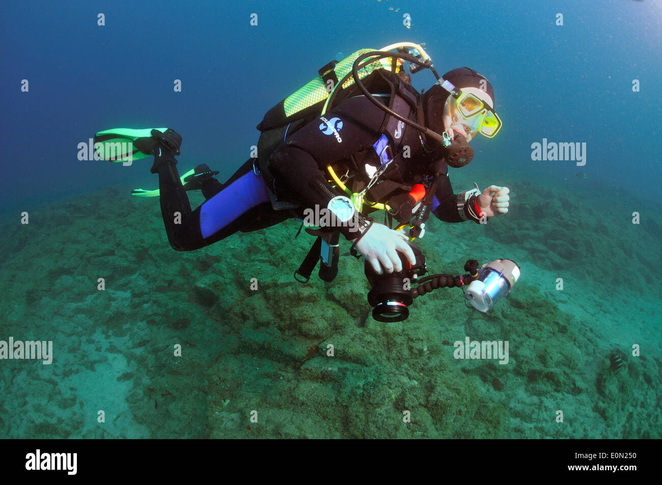 Scuba diver underwater with camera, Tenerife Stock Photo
