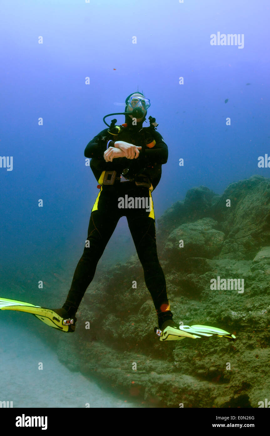 Scuba diver relaxing on dive, Tenerife Stock Photo