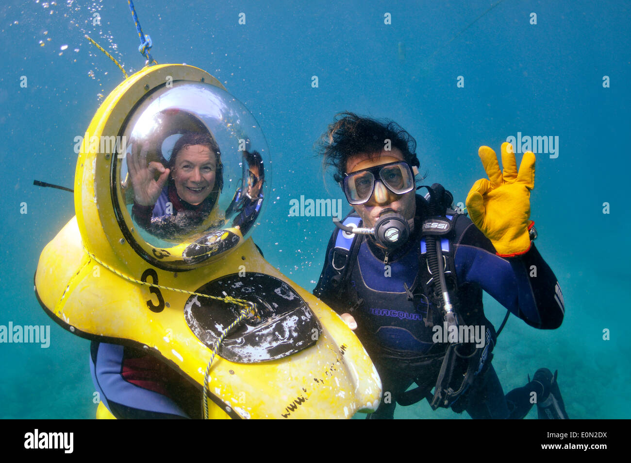 "BOB ""The Breathing Observation Bubble"" scooter diver underwater with scuba diver both giving OK sign, Tenerife Stock Photo"