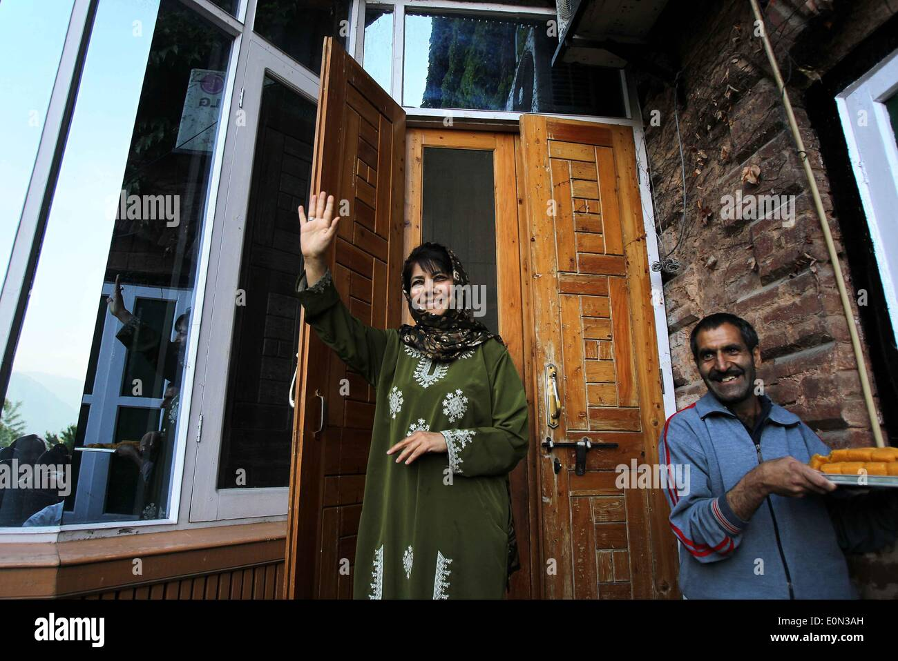 Srinagar, Srinagar the summer capital of Indian-controlled Kashmir. 16th May, 2014. Mehbooba Mufti, president of Indian controlled Kashmir's main opposition party, Peoples Democratic Party (PDP), waves to her supporters after she was declared winner for a parliamentary seat, in Srinagar the summer capital of Indian-controlled Kashmir, May 16, 2014. The region's main opposition Peoples Democratic Party (PDP) and right-wing Hindu nationalist Bhartiya Janta Party (BJP) Friday swept polls by winning three seats each in the region, officials said. Credit:  Javed Dar/Xinhua/Alamy Live News - Stock Image