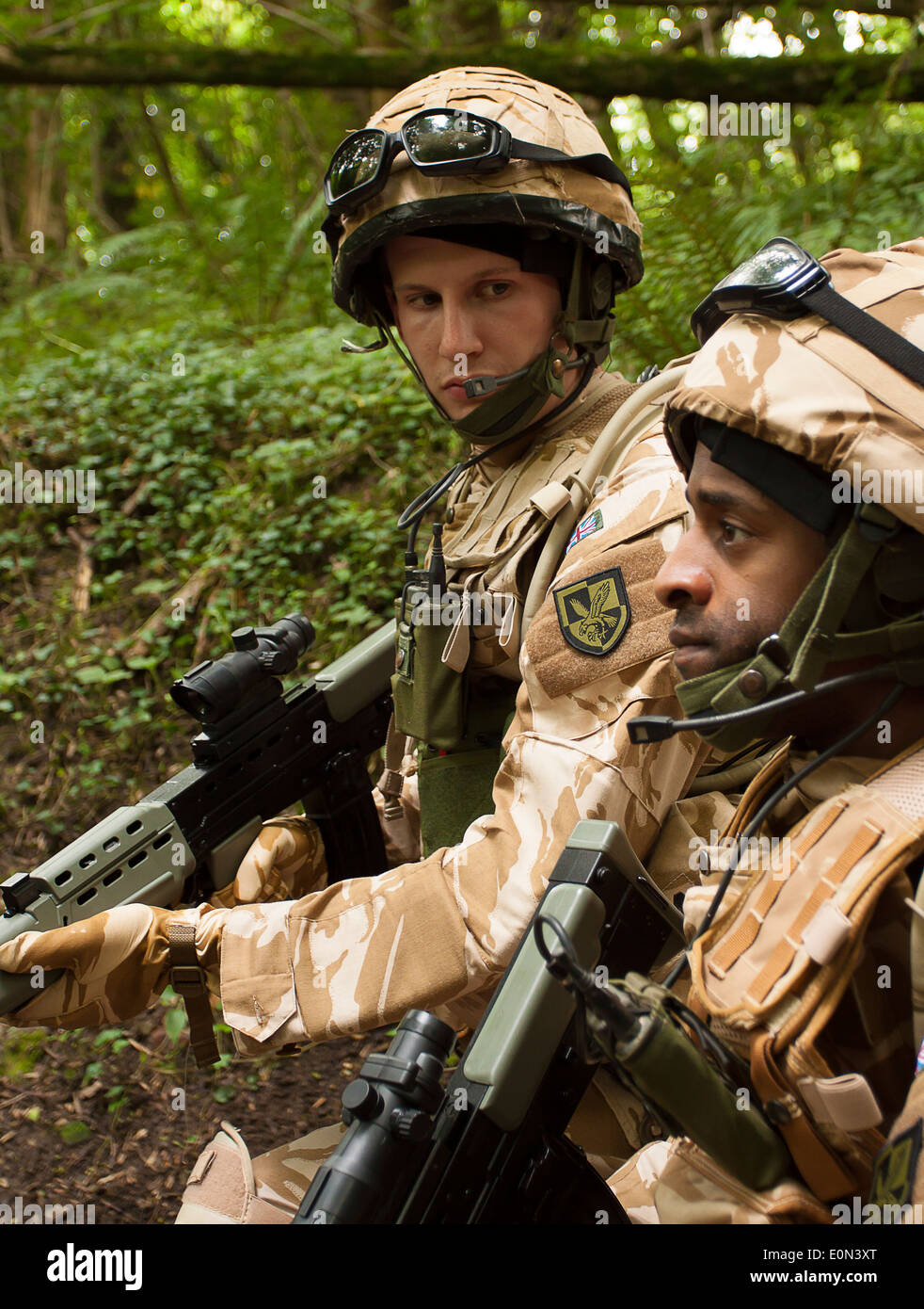 Soldiers in full British Army uniform on armed patrol - Stock Image
