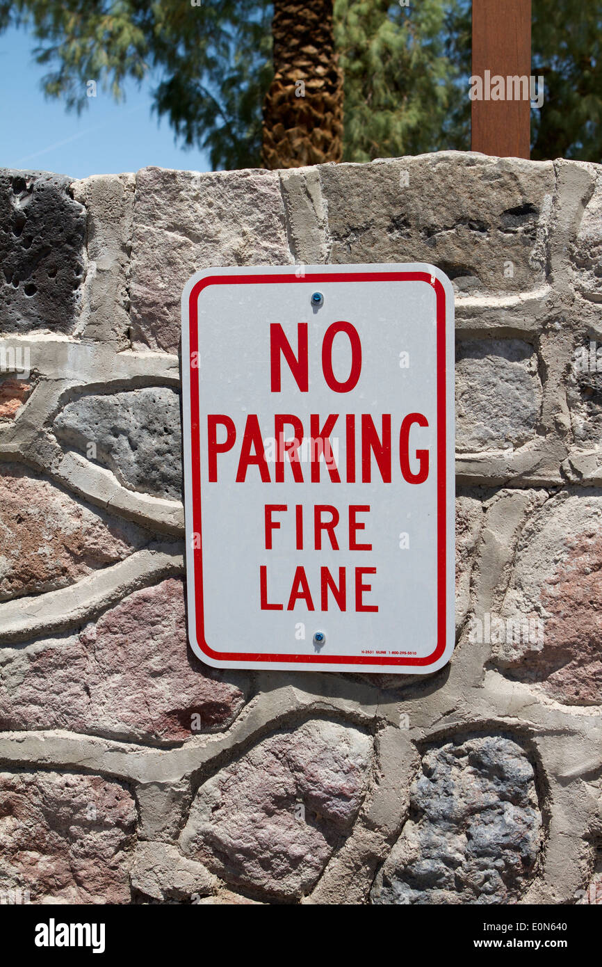 No Parking Fire Lane sign on a natural stonewall Stock Photo