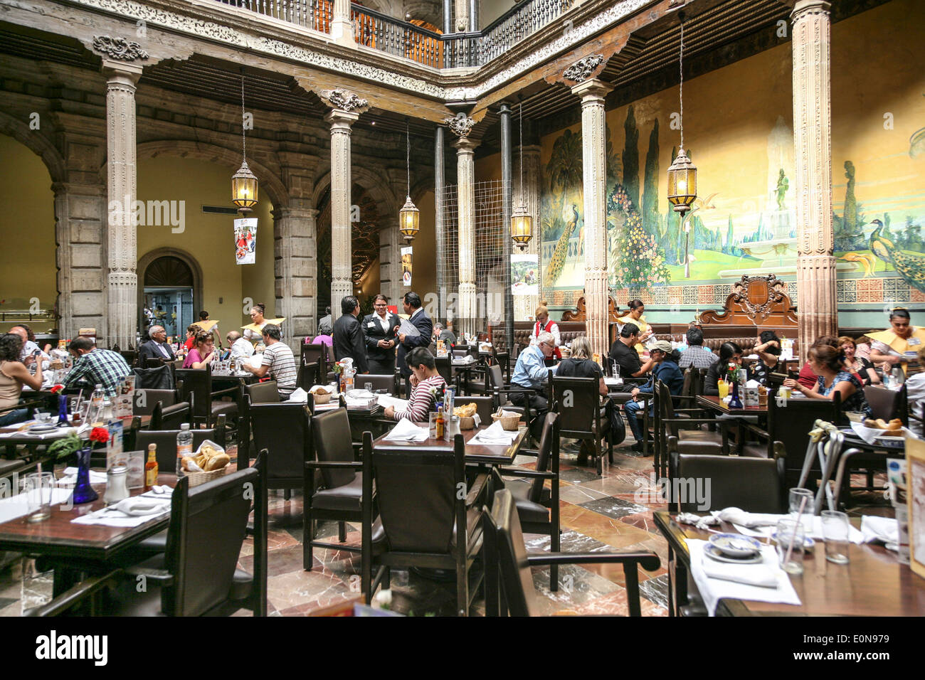 diners of all ages enjoy a wonderful dining ambiance in soaring central court of Sanborns House of Tiles restaurant Mexico City - Stock Image