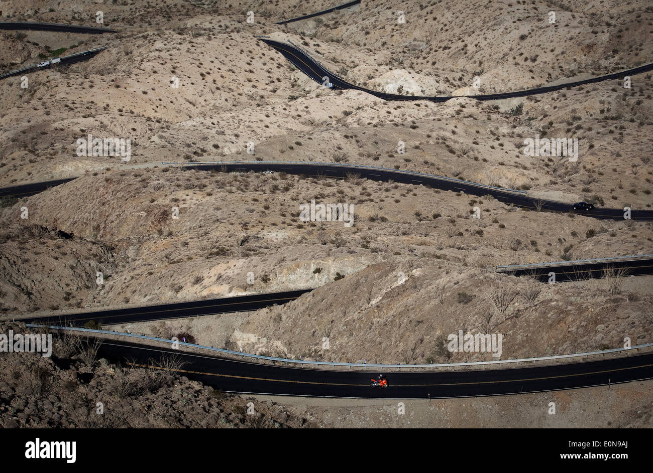 Palm Desert, California, USA. 11th Dec, 2013. A lone motorcycle makes its way up a winding stretch of Highway 74 outside of Palm Desert, Calif. Known as the ''Pines to Palms Highway, '' the scenic trek takes drivers from the desert floor up into the San Jacinto Mountains. © John Schreiber/ZUMAPRESS.com/Alamy Live News - Stock Image