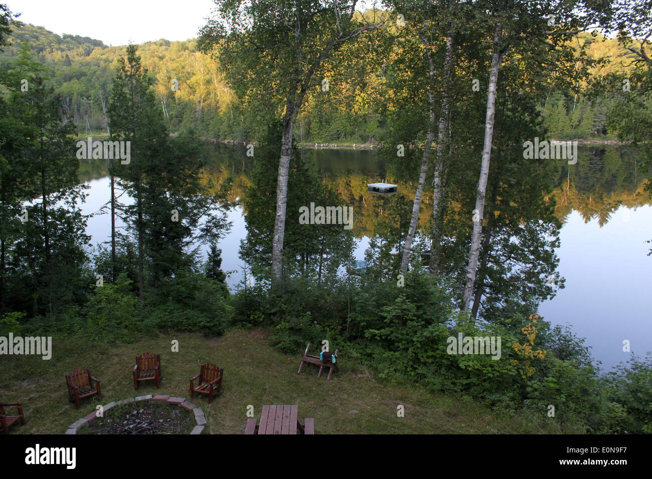 Small lake in cottage country in Quebec, Canada - Stock Image