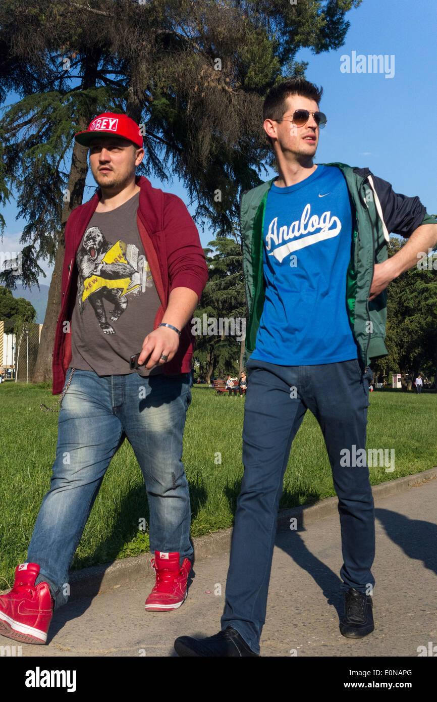 men walking in park, Tirana, Albania Stock Photo