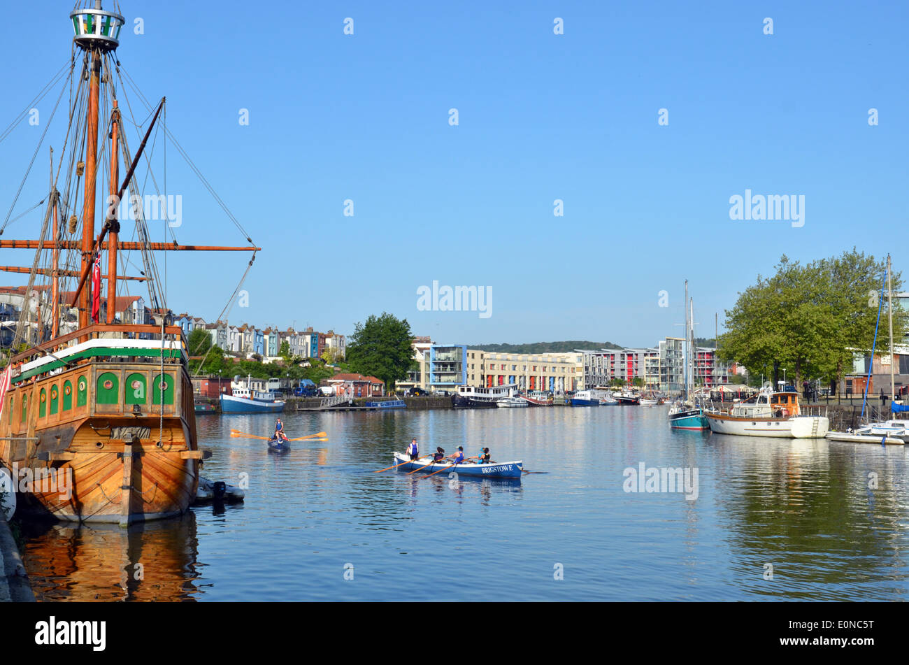Bristol, UK. 17th May, 2014. Early morning rowers seen next to The Sailing Ship the Matthew in the Floating Harbour in the City of Bristol in the UK ,as the sun rises to a wonderfull day ahead. Forecasters are predicting warm and sunny weather for the weekend. Credit:  Robert Timoney/Alamy Live News - Stock Image