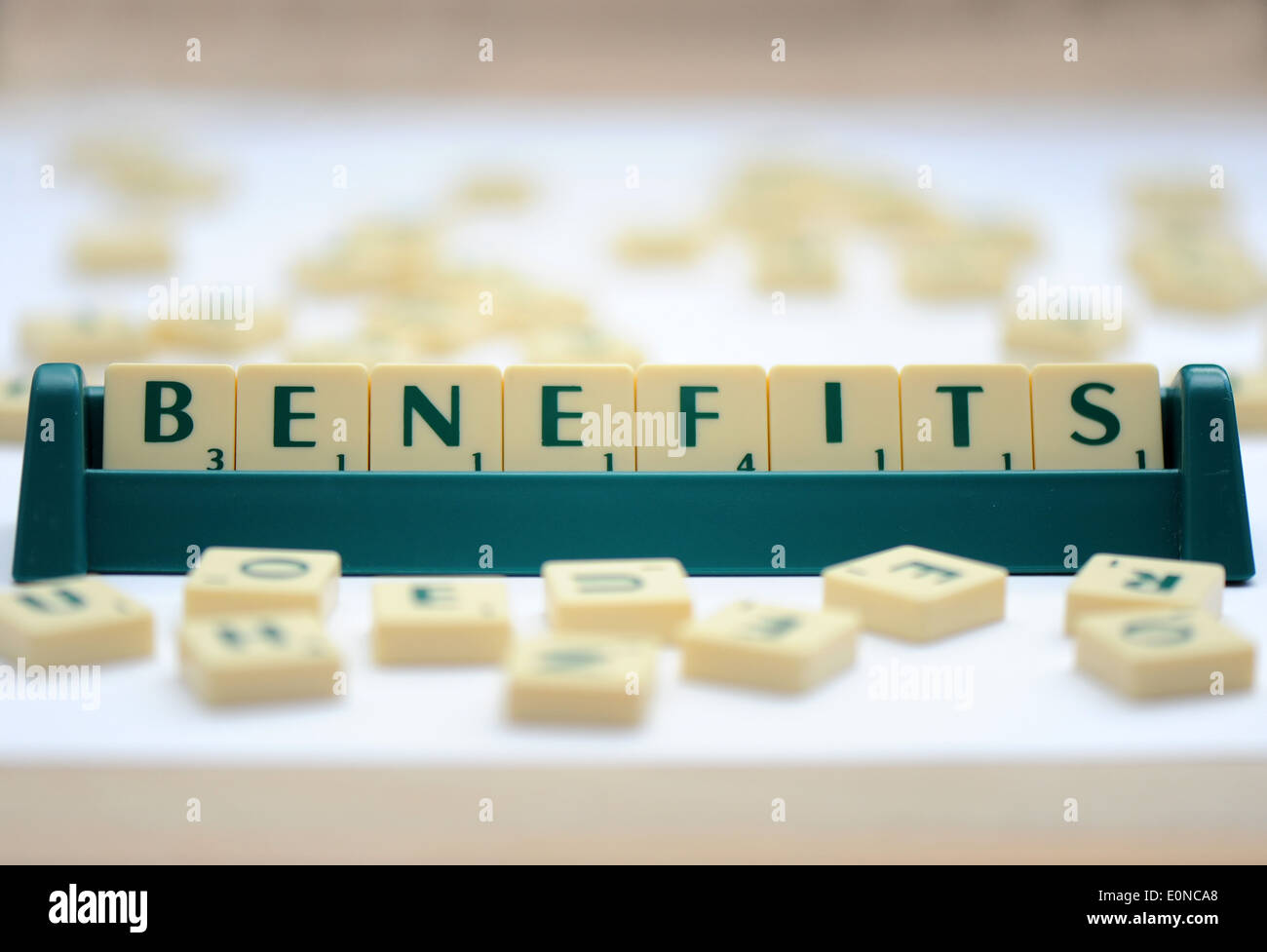 Scrabble tiles reading out the words benefits - Stock Image