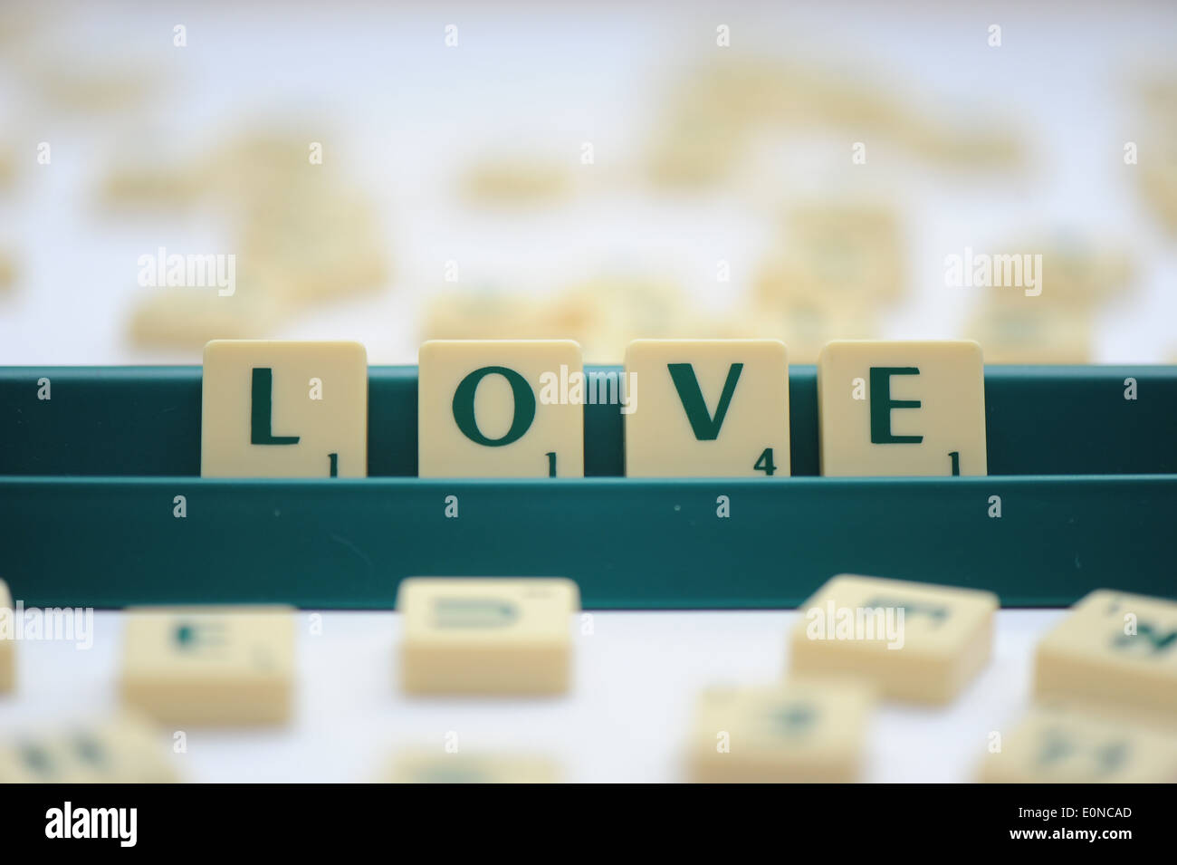 Scrabble tiles reading out the words love - Stock Image