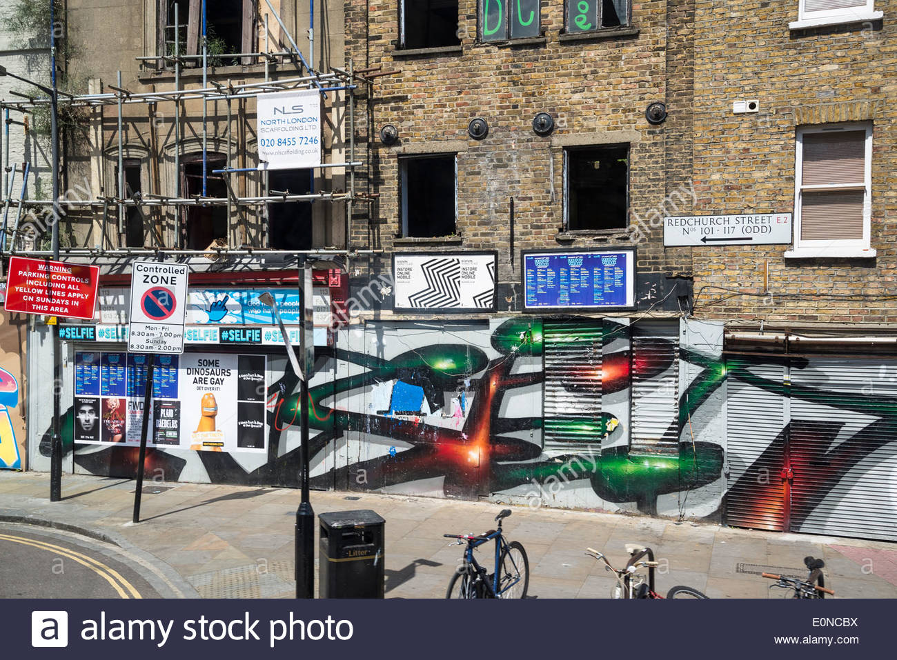 Graffiti and construction work, Bethnal Green Road, Shoreditch,, East London, - Stock Image