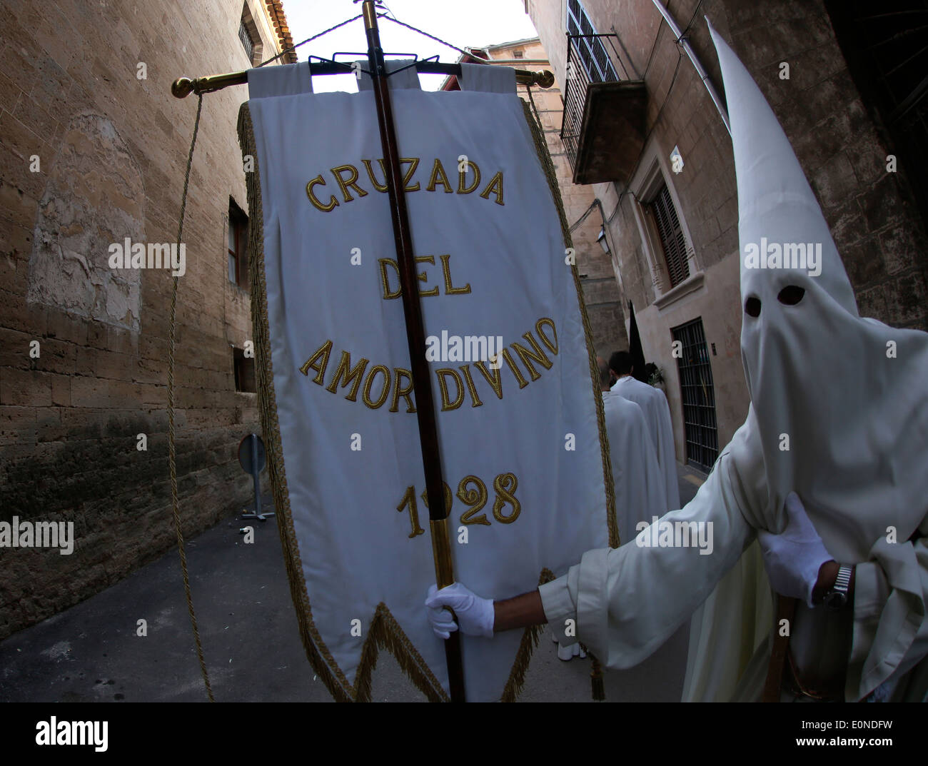 Penitents seen during the celebration of an easter Sunday palm procession in the island of Majorca, Spain - Stock Image