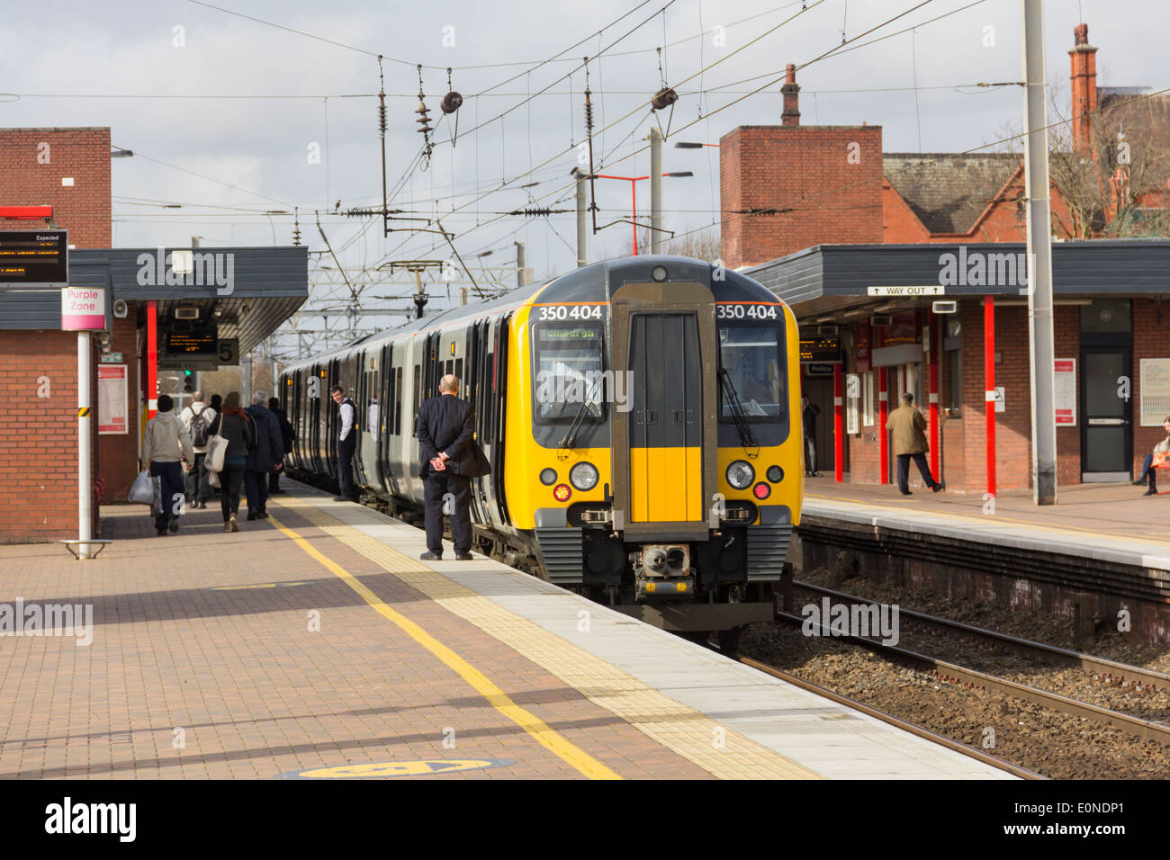 Manchester to Glasgow TransPennine Express Class 350 Desiro EMU train standing at Wigan North Western Station. - Stock Image