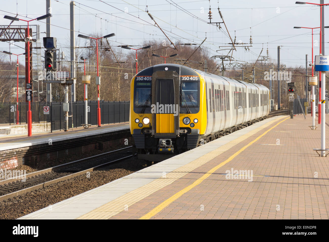 Manchester to Glasgow TransPennine Express Class 350 Desiro EMU train arriving at Wigan North Western Station. - Stock Image