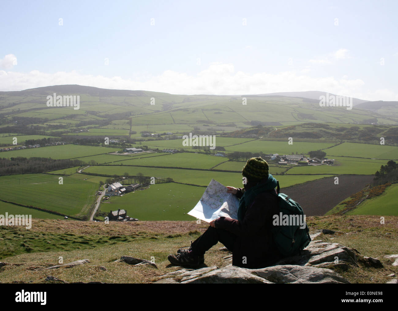 Hiker on Hill with Map - Stock Image