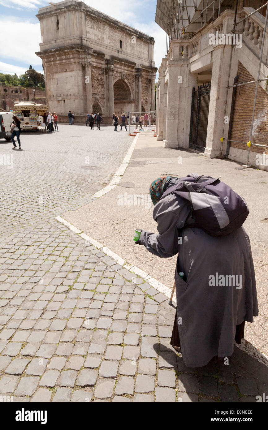 An old woman beggar begging on the streets of Rome, Italy Europe - Stock Image