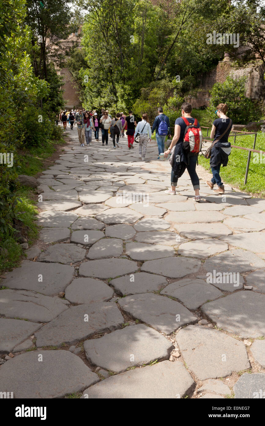 Tourists walking on the Via Sacra, the oldest road in Rome, the Forum, Rome Italy Europe - Stock Image