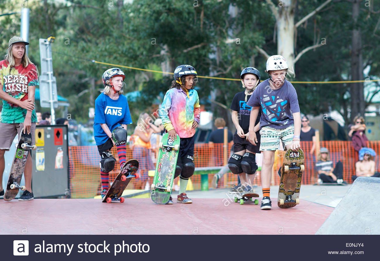 Young skaters, waiting their turn to perform/compete at the Nimbin skate park competition; during Mardigrass, 2014. - Stock Image