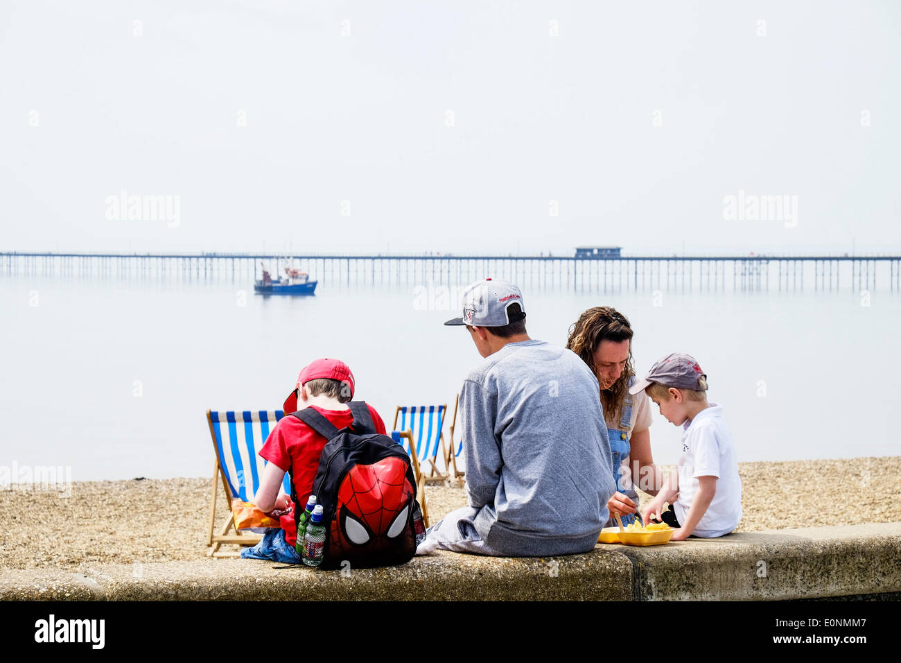 Southend on Sea, Essex, UK. 17th May, 2014.  A family eating fish and chips on Southend seafront on what is proving to be the hottest day of the year so far.  Photographer: Gordon Scammell/Alamy Live News - Stock Image