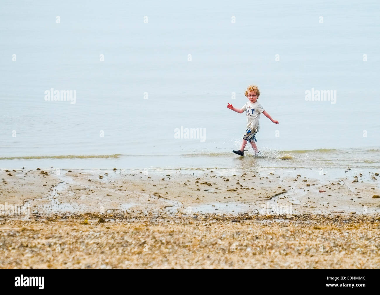 Southend on Sea, Essex, UK. 17th May, 2014.  A young lad enjoys his run along the Jubilee Beach in Southend on Sea as the temperature starts to build into what will prove to be the hottest day of the year so far.  Photographer: Gordon Scammell/Alamy Live News - Stock Image