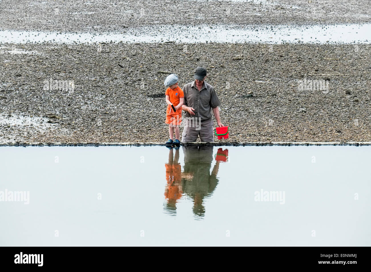 Southen on Sea, Essex. 17th May, 2014.  A young boy fishing for crabs with his grandfather on the beach at Southend on Sea as the temperature starts to rise on what is proving to be the hottest day of the year so far.  Photographer: Gordon Scammell/Alamy Live News - Stock Image