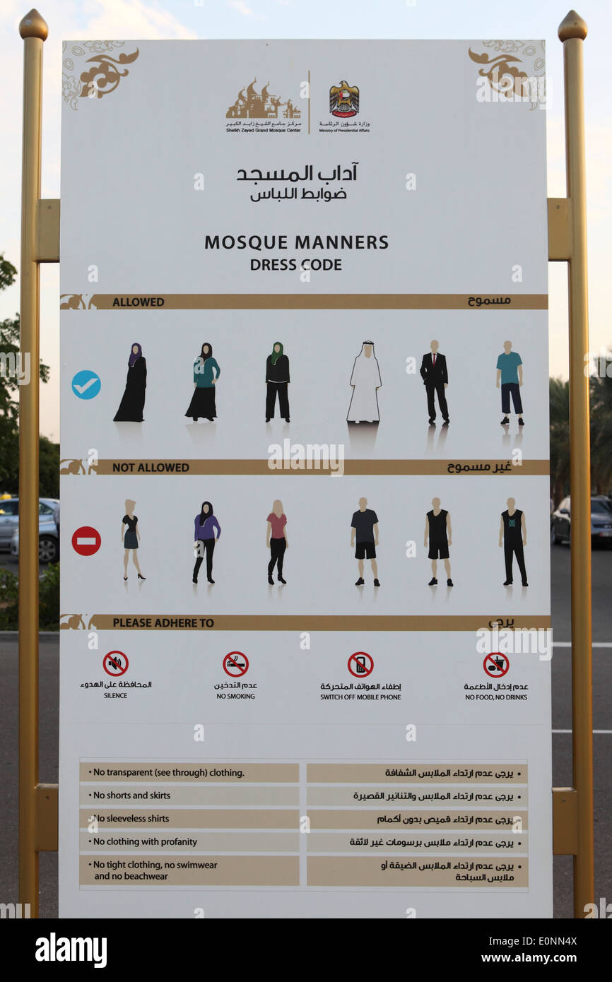 Sign showing the dress code for entry into the Sheikh Zayed Grand Mosque in Abu Dhabi. - Stock Image