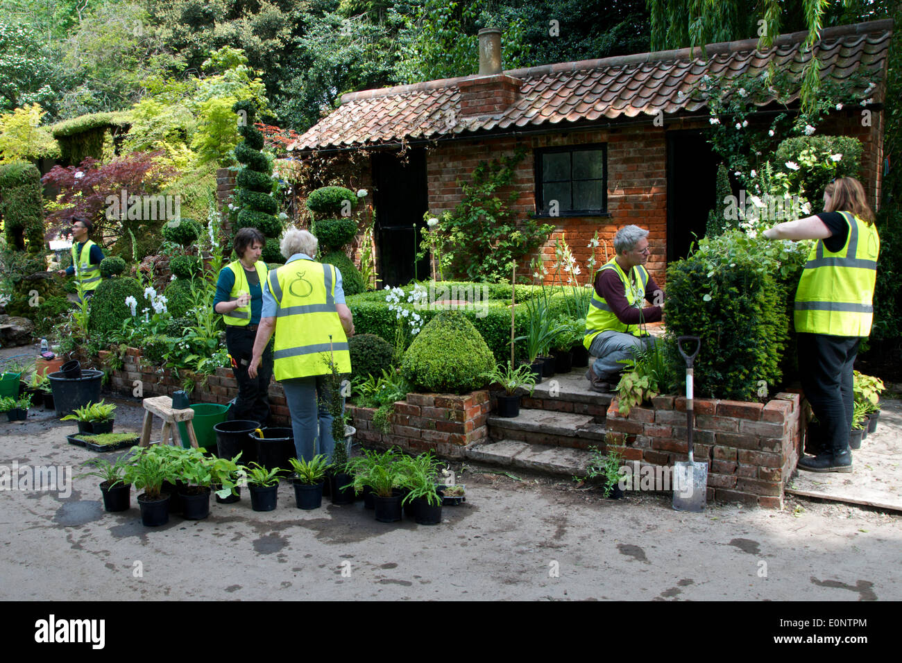 A Team Of Gardeners Finish Preparing Artisan Show Garden U0027The Topiarist  Garden At West Green Houseu0027, Designed By Marylyn Abbott Ready For Opening  At RHS ...