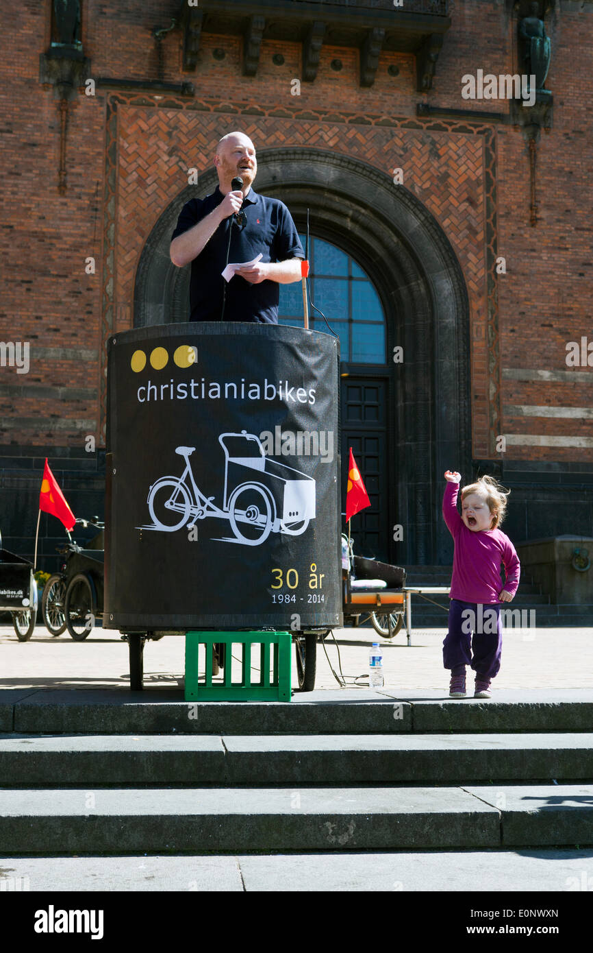 "Copenhagen, Denmark – May 17th, 2014: ""More than 40% of the Copenhagener takes daily their bike to work "", says Environmental Mayor of Copenhagen, Morten Kabell, in his speech to the Christiania bike enthusiasts, which gathered at the town hall square for celebrating the iconic Christiania bikes 30 years anniversary. Mr. Kabell added that a survey indicates that alone last year the number of daily job bikers grew with 5%. One reason to this: Broader and safer cycle paths, bikers dedicated traffic lights etc. ""This trend is very important for the traffic conditions in Copenhagen"", he said. - Stock Image"