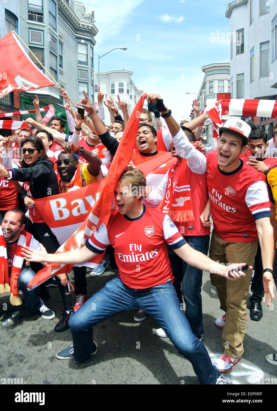 arsenal fans celebrate FA cup championship win on Grant Street San Francisco - Stock Image