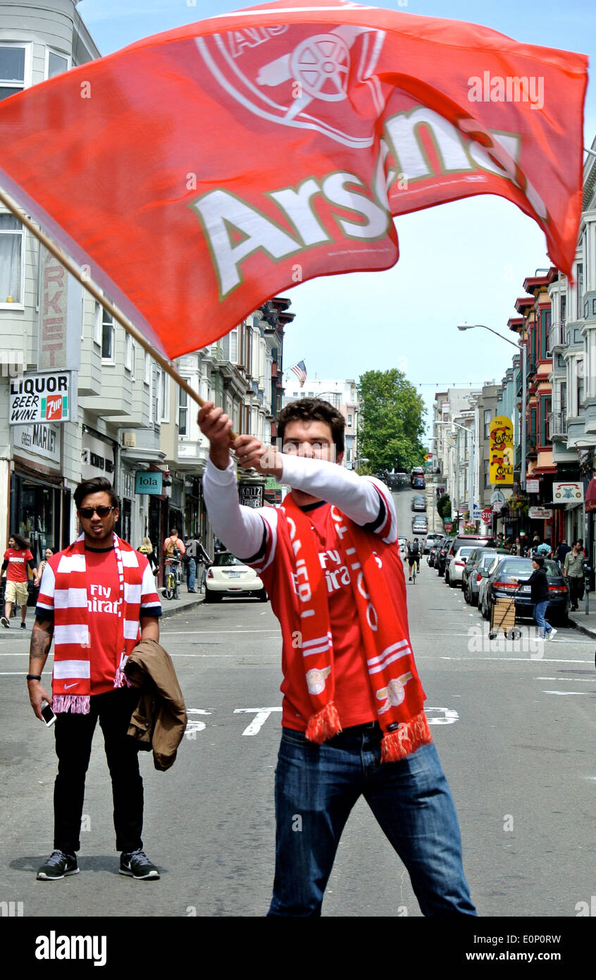 San Francisco, CA, USA. 18th May, 2014. happy fan on grant Street San Francisco waves Arsenal flag following Arsenal's FA cup championship victory in England Credit:  Bob Kreisel/Alamy Live News - Stock Image