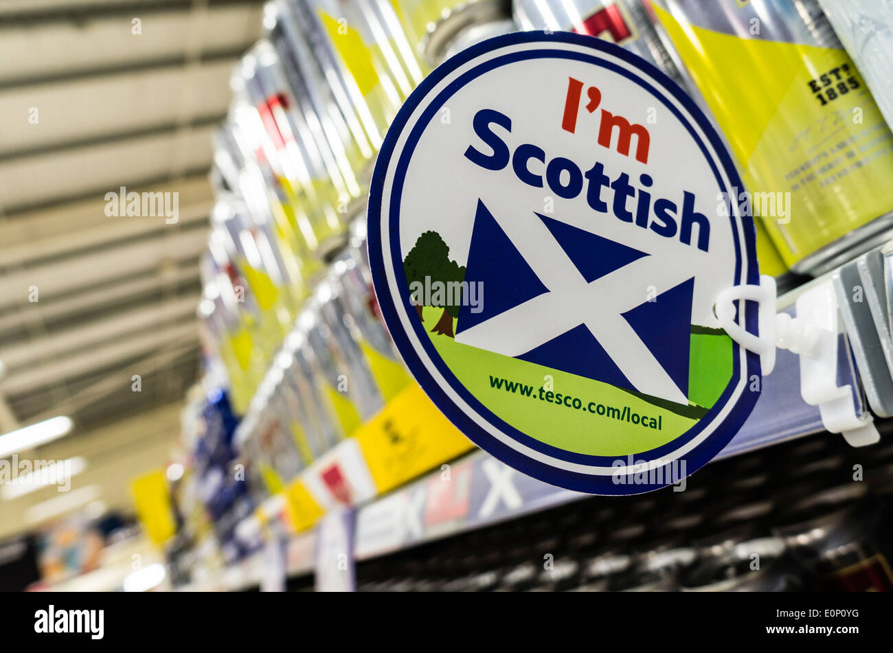 Tesco in Scotland selling Scottish lager beer - playing the local loyalty and support card. Scotland now has minimum pricing for alcohol. - Stock Image