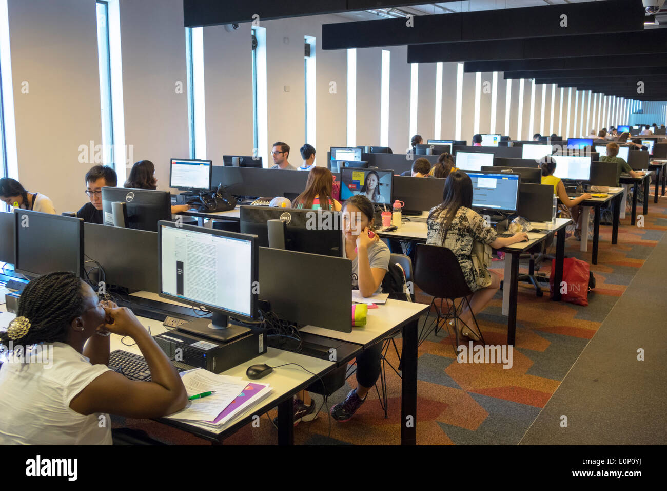 Sydney Australia NSW New South Wales University of Sydney education campus student Fisher Library Black girl woman teen Asian computer stations screen - Stock Image