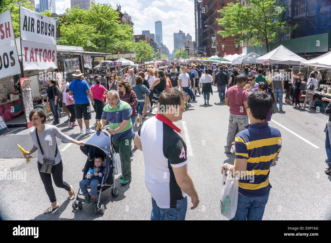 Hells Kitchen, New York City, Saturday, May 17 2014, USA: opening day of 2 day weekend 9th Avenue International Food Festival. Inaugurated in 1973, the festival extends from 57th to 42nd street along Ninth Avenue in New York's Hells Kitchen neighborhood. Credit:  Dorothy Alexander/Alamy Live News - Stock Image