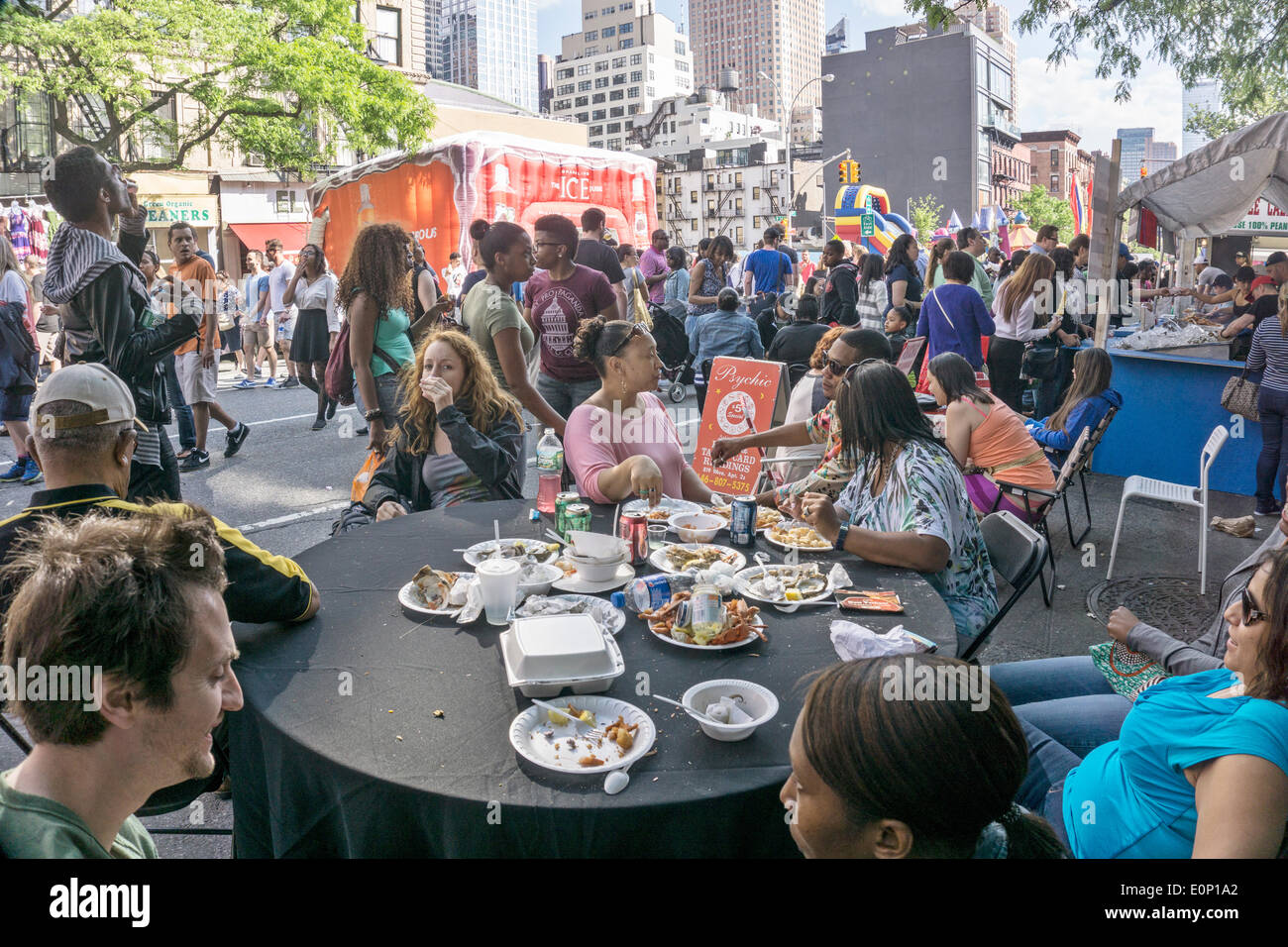 Hells Kitchen, New York City, Saturday, May 17 2014, USA: view of the crowd on opening day of 2 day weekend 9th Avenue International Food Festival. Inaugurated in 1973, the festival extends from 57th to 42nd street along Ninth Avenue in New York's Hells Kitchen neighborhood. Credit:  Dorothy Alexander/Alamy Live News - Stock Image