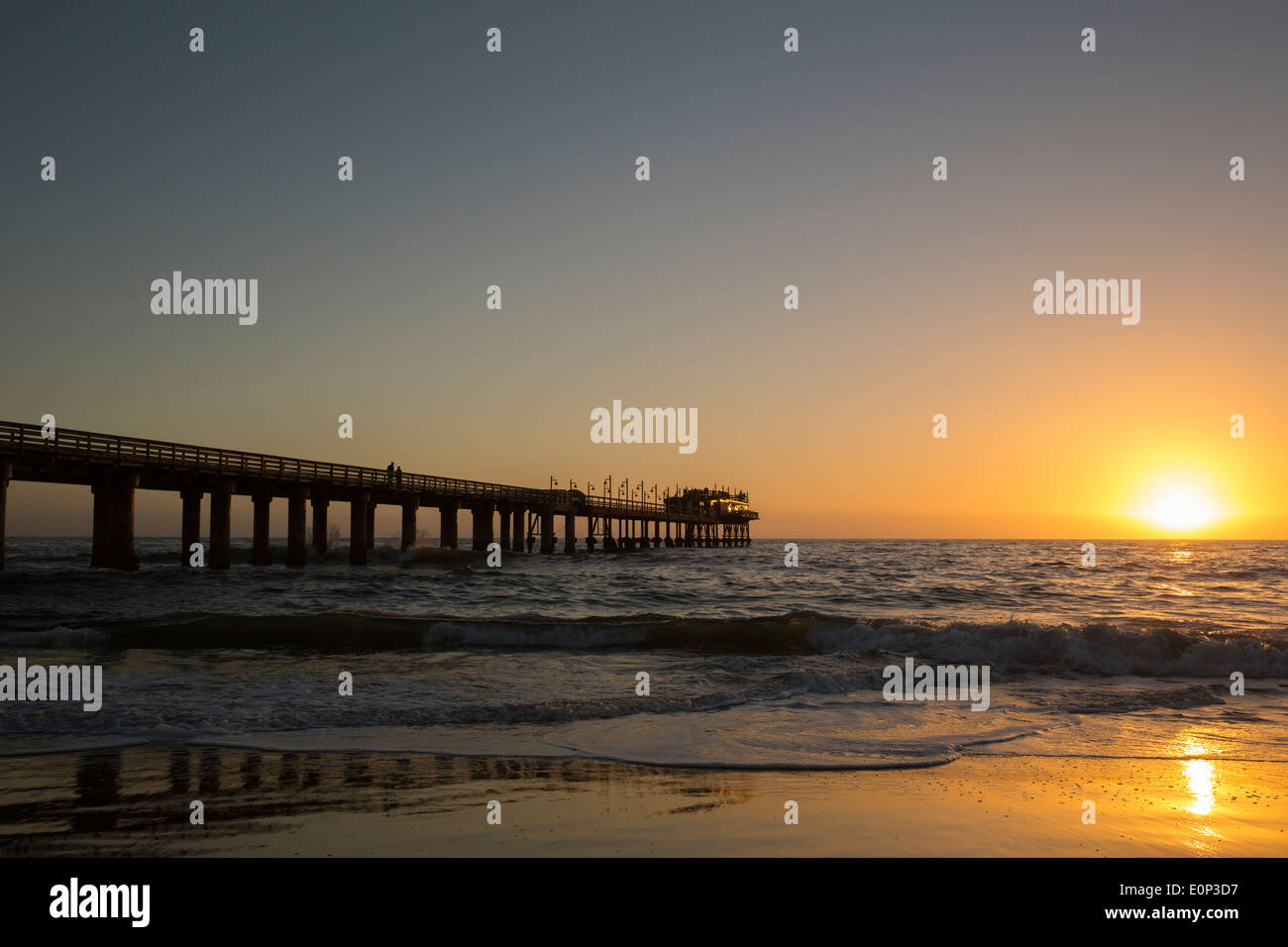 Sunset over Swakopmund Jetty and Atlantic ocean - Stock Image