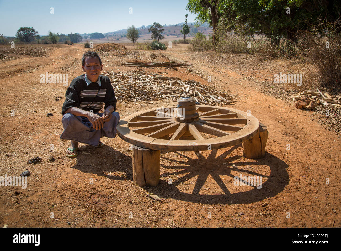 A travelling wheelwright with a new cartwheel, Myanmar - Stock Image