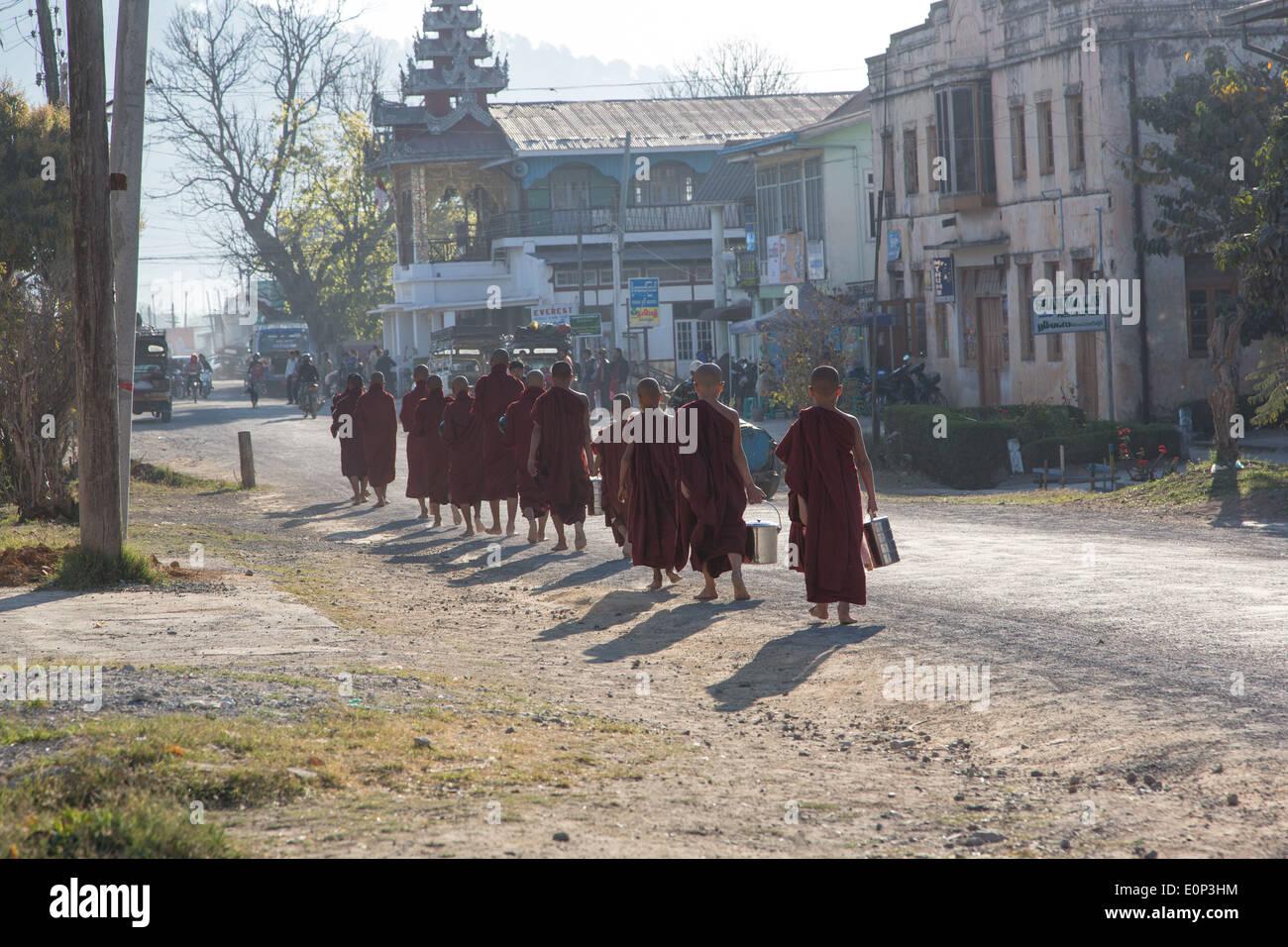 Monks collecting alms, Kalaw, Myanmar Stock Photo