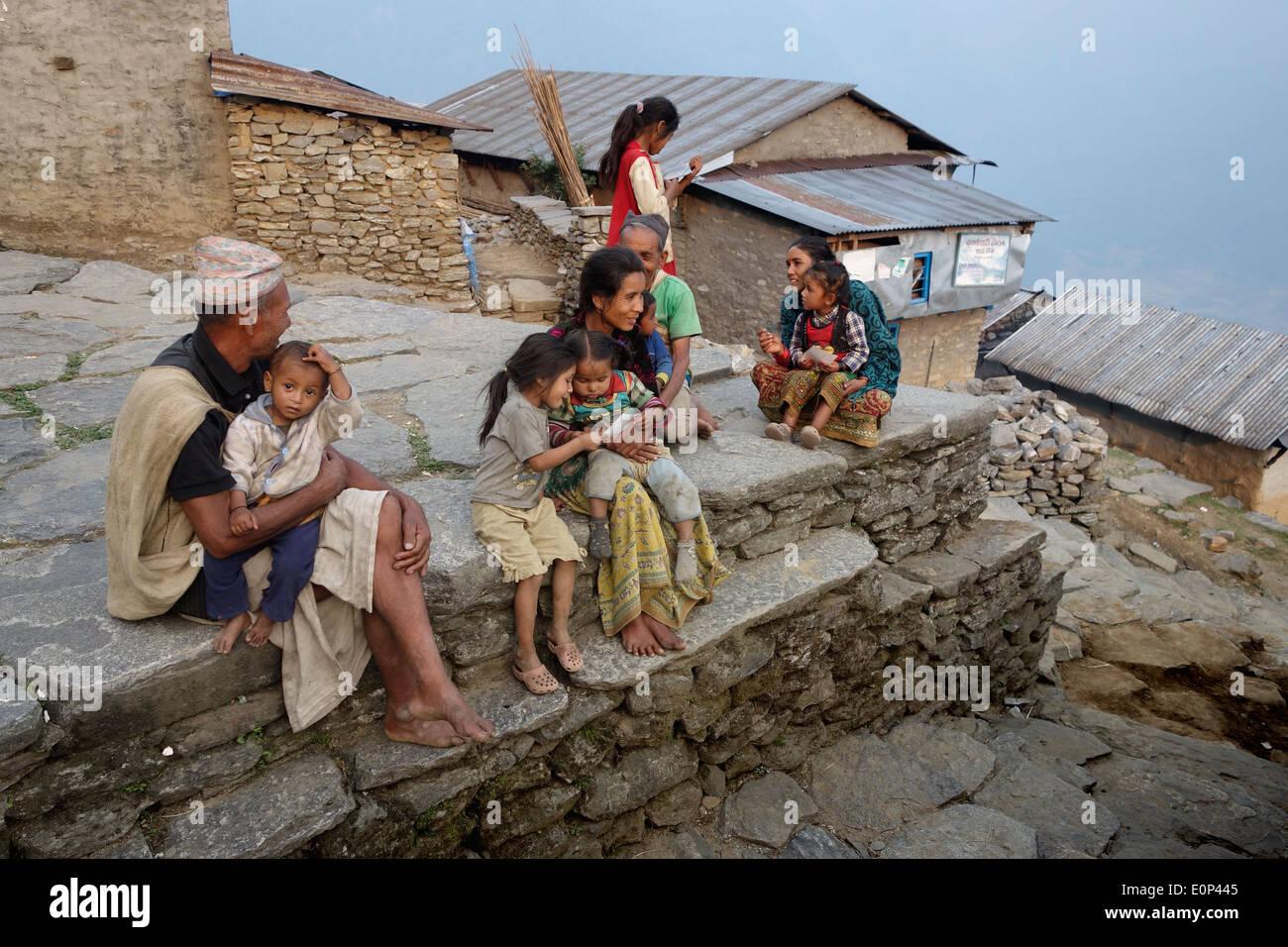 Nepalis family having evening rest - Stock Image