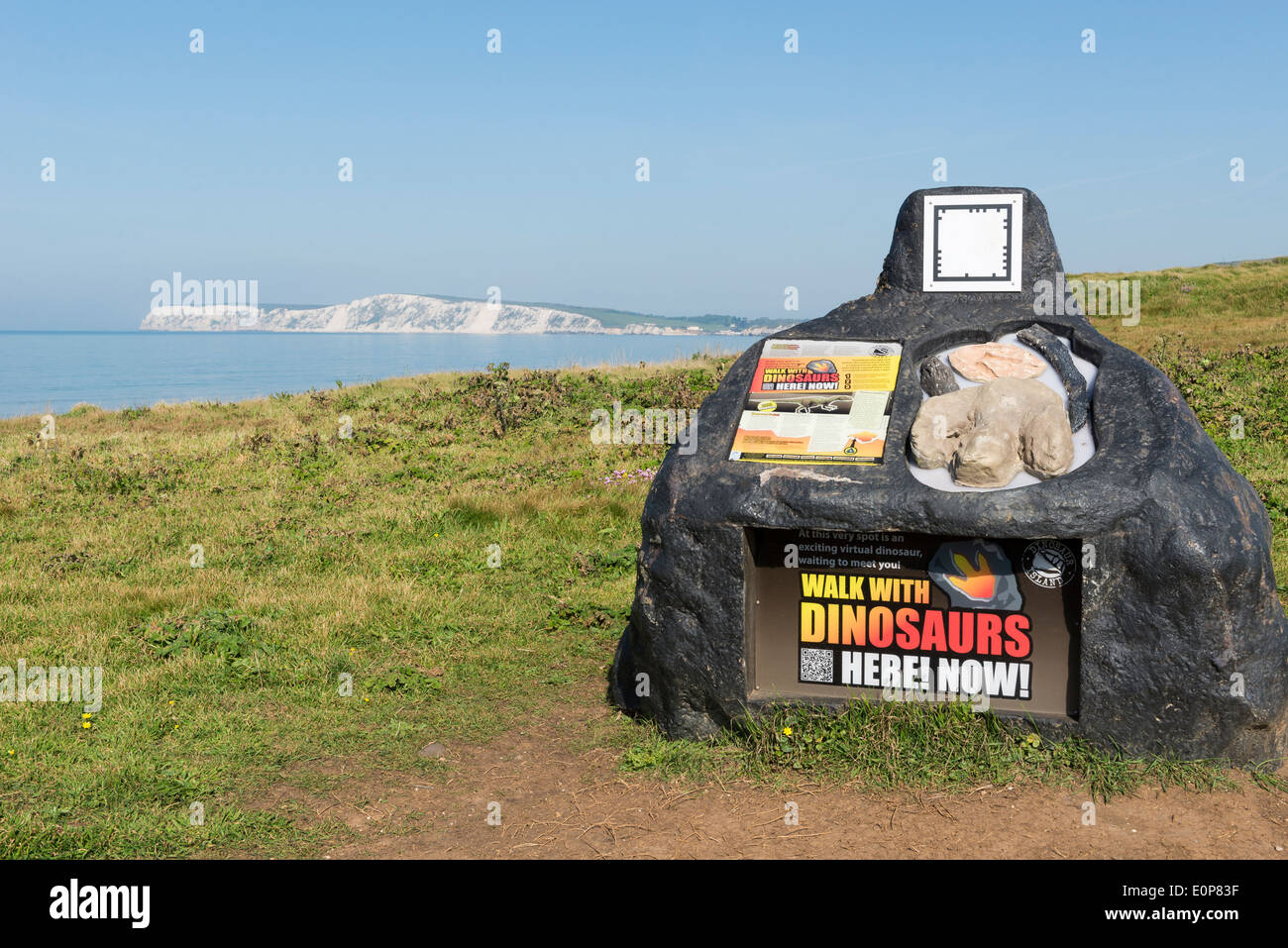Walk with dinosaurs where you can download an app and at this spot is an exiting virtual dinosaur waiting to meet you. IOW Stock Photo
