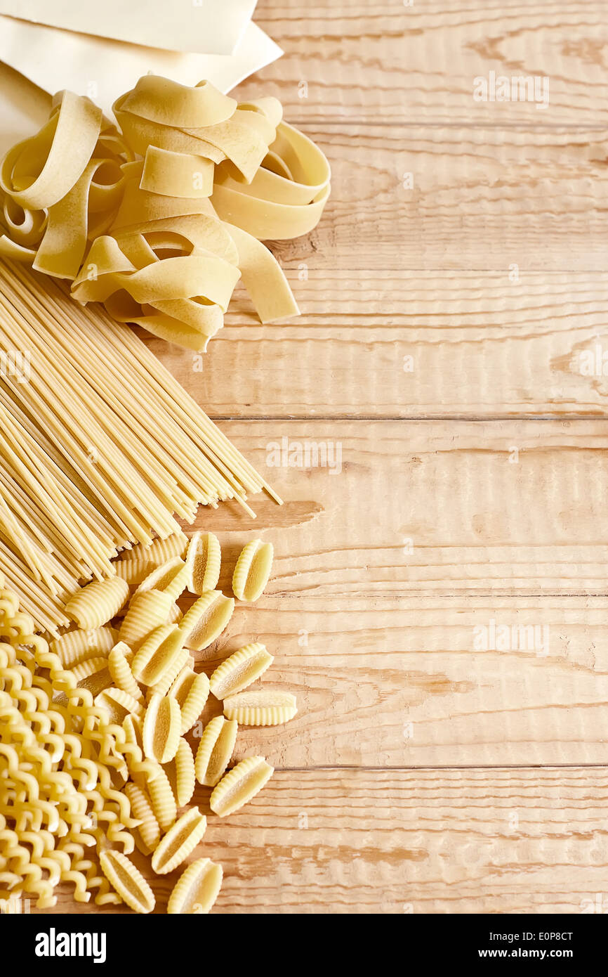 Mix of dry pasta. Copy space background. - Stock Image