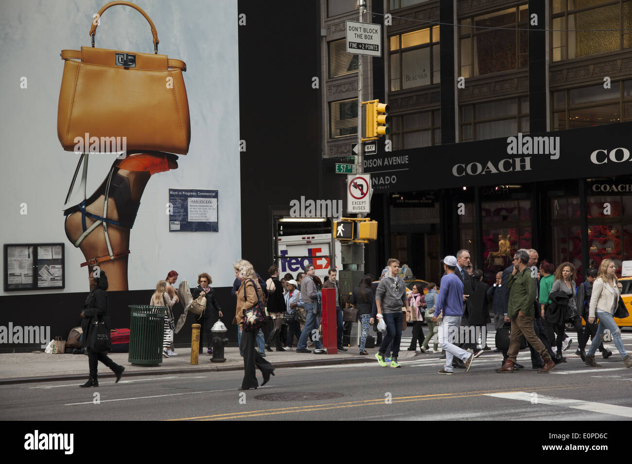 'High end', 'bigger than life' advertising for the wealthy at Madison Ave. & 57th St. in Manhattan, NYC. - Stock Image
