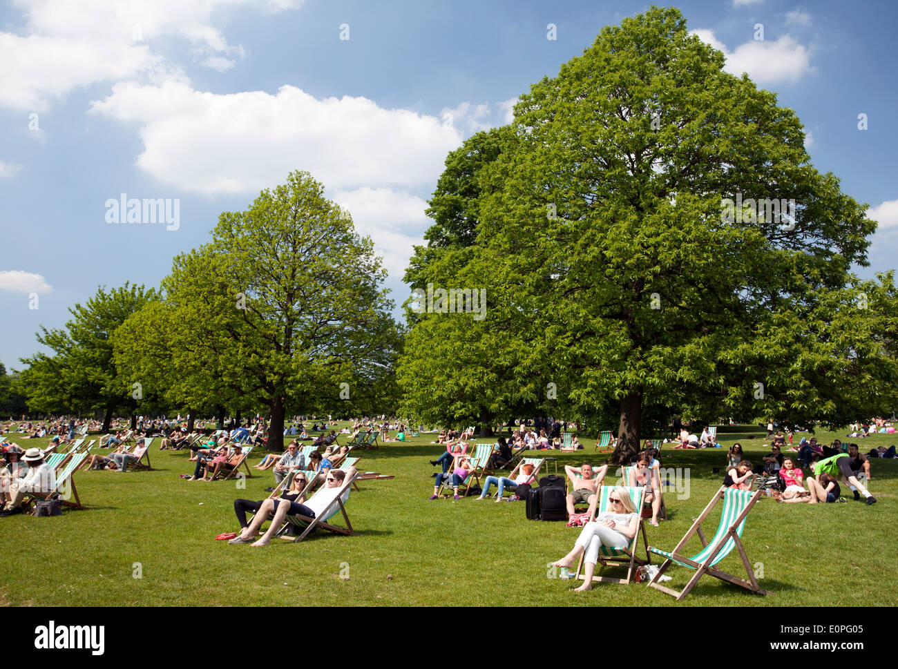 People enjoy a sunny May day in Hyde Park, London - Stock Image