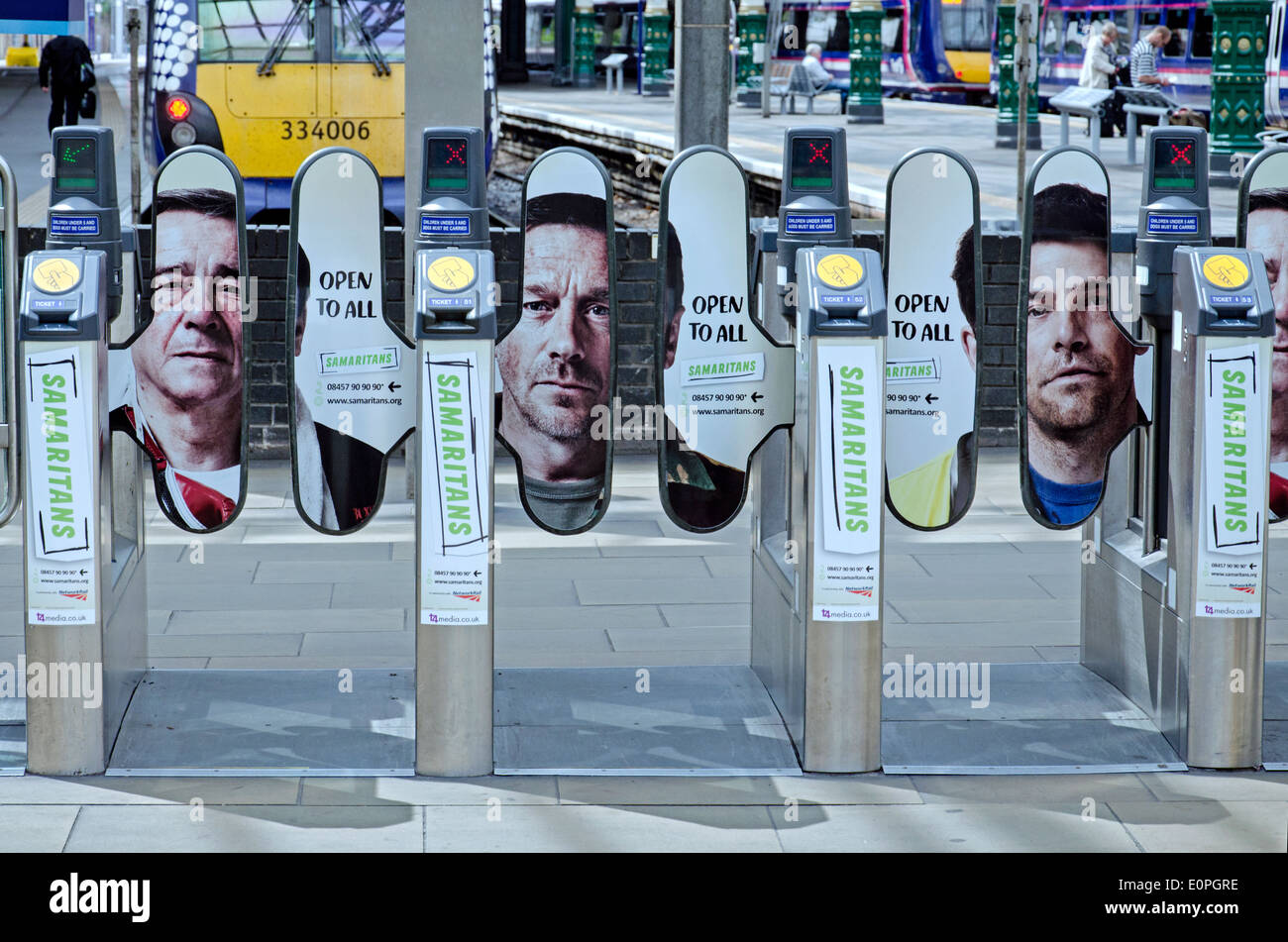 Adverts for the Samaritians charity on the barriers at Waverley Station in Edinburgh, Scotland, UK. - Stock Image