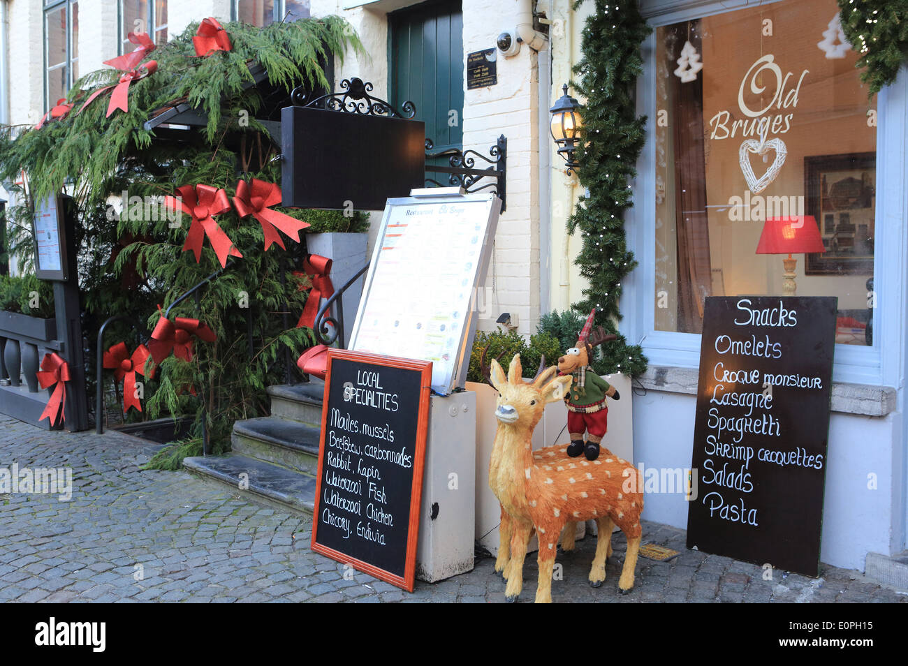 festive christmas decorations and menu outside a restaurant in the old town of brugesbrugge