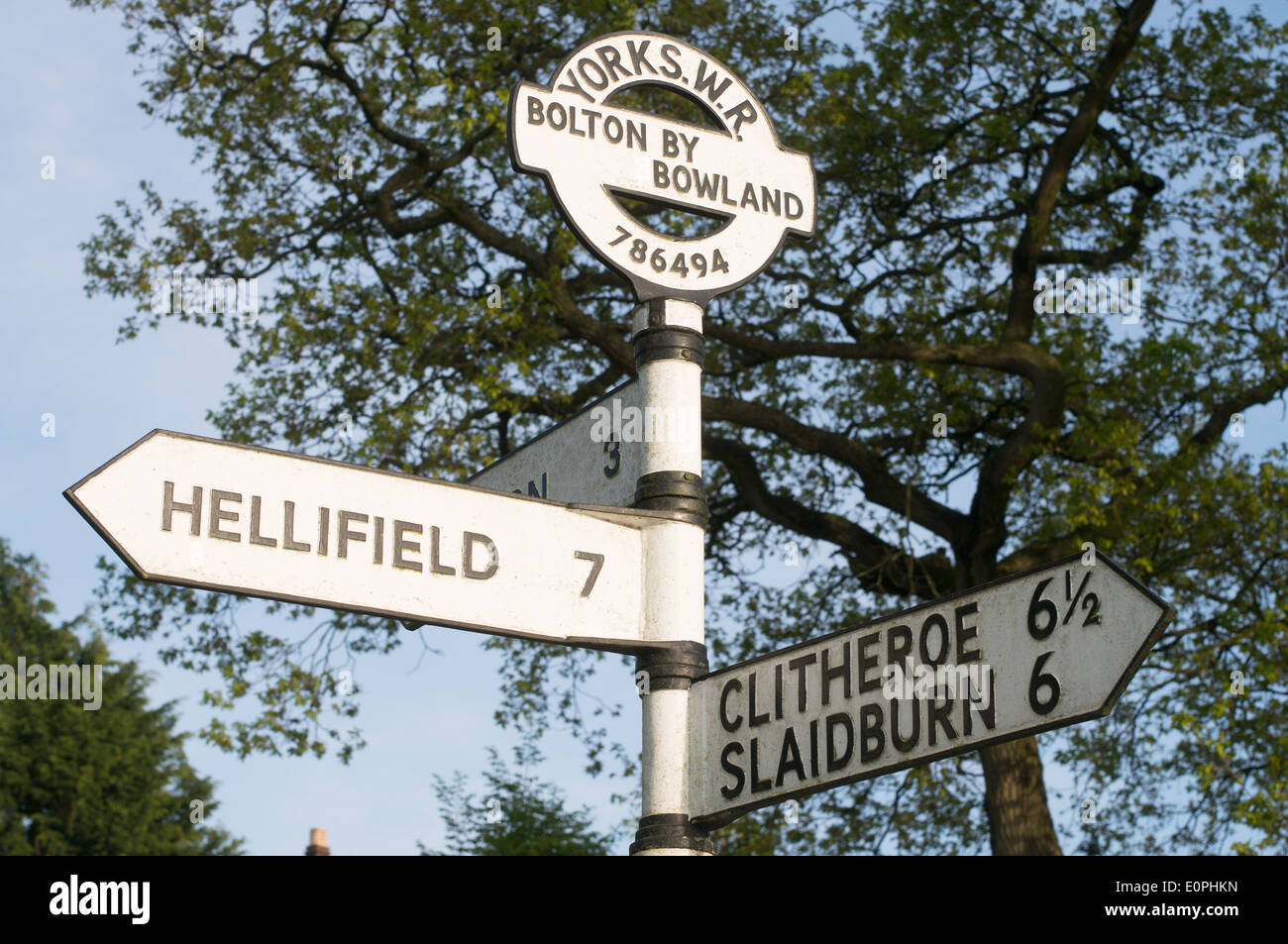 Old cast iron road sign in Bolton-by-Bowland, Lancashire, England, UK - Stock Image