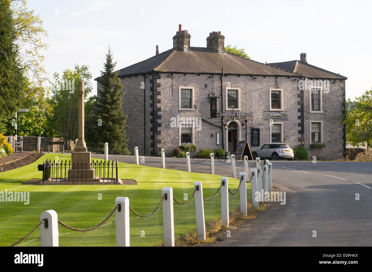 War memorial and Coach and Horses Inn, Bolton-by-Bowland, Lancashire, England, UK - Stock Image