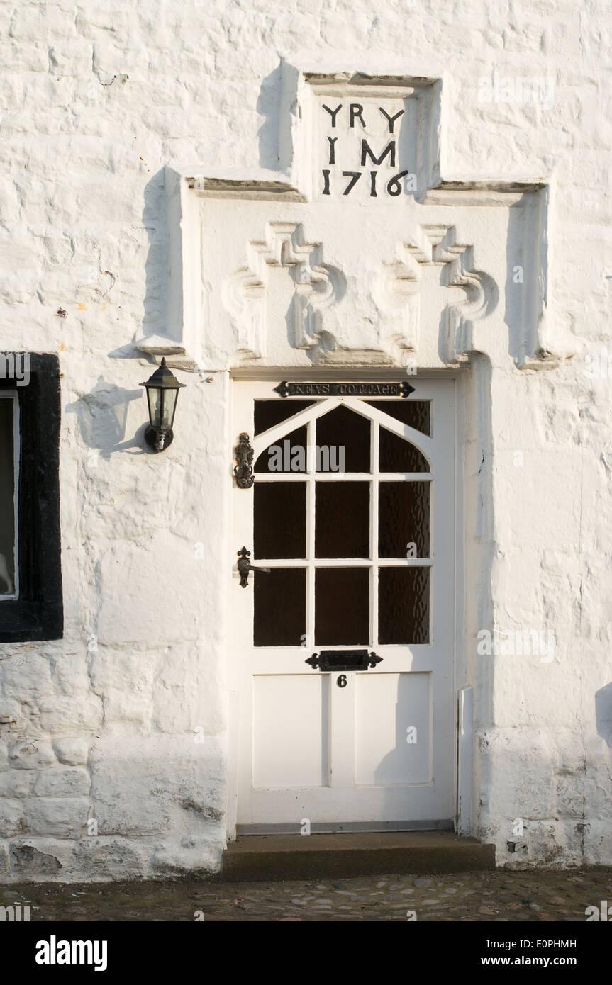 Door of 18th century cottage Bolton-by-Bowland, Lancashire, England, UK - Stock Image