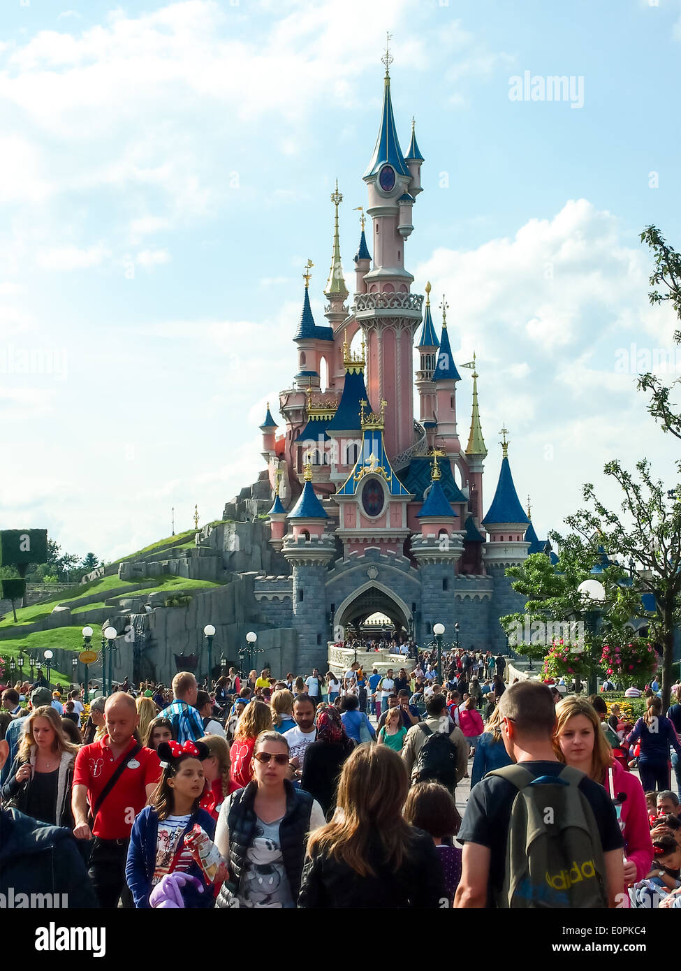 Tourists in front of Sleeping Beauty's castle at Disneyland Paris, france - Stock Image