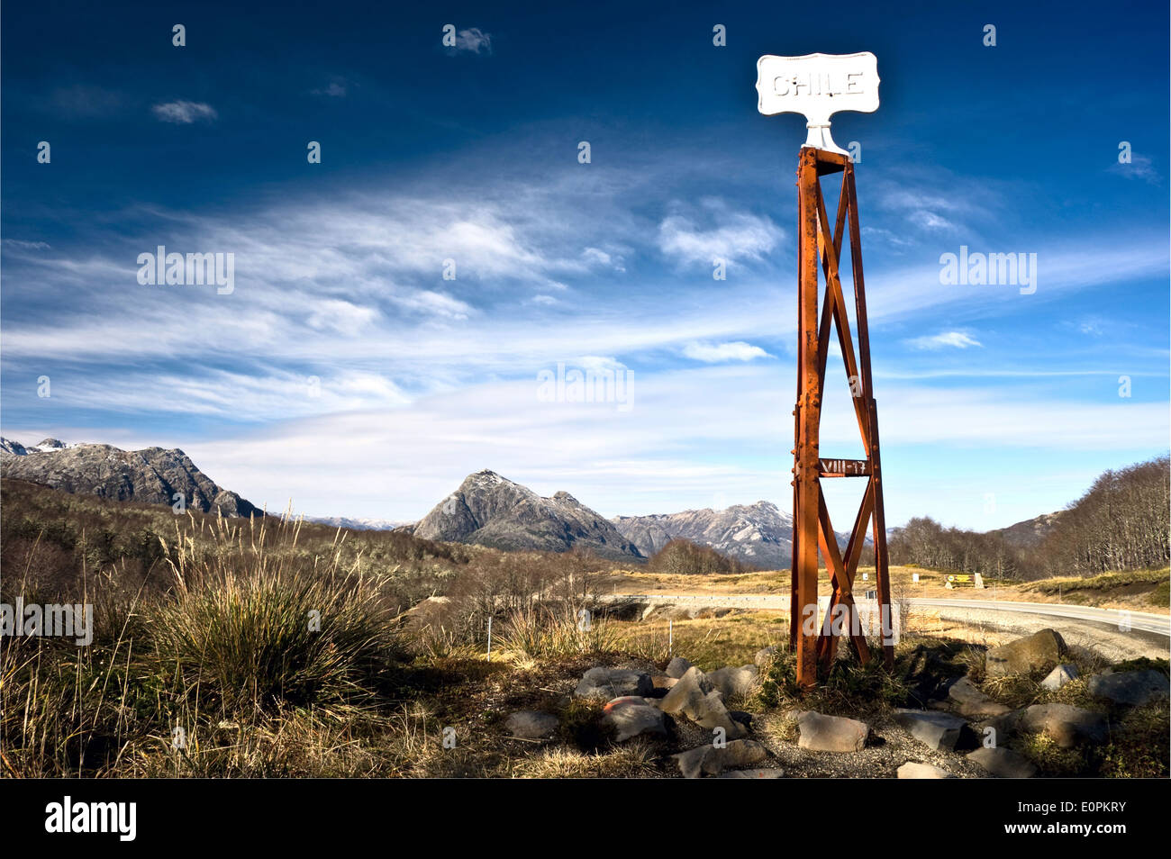 Chile Vintage grungy border post, Road sign at the Patagonia border of Argentina and Chile in Paso Cardenal Samore - Stock Image